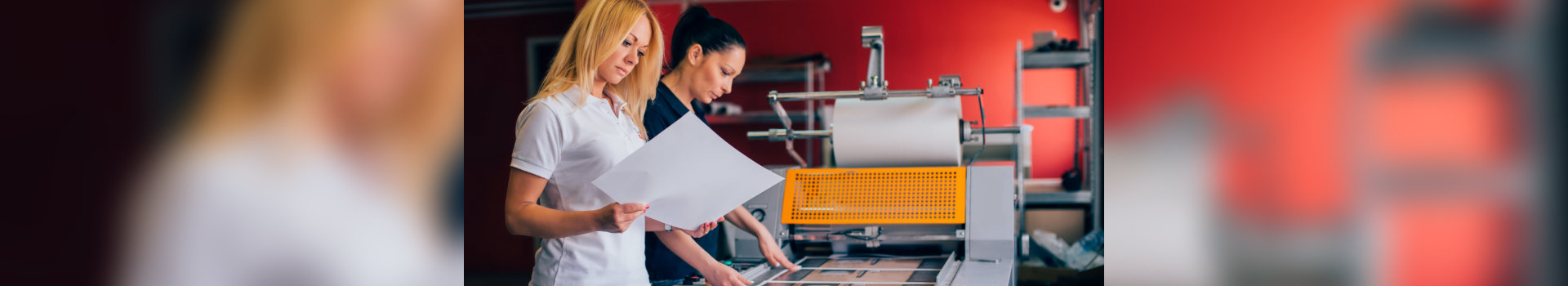 two young woman working in printing factory